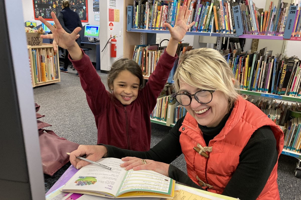 teacher and student at the library